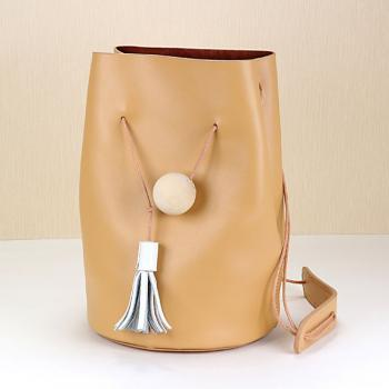 Minimal Leather Bucket Bag with Tassel Detailing